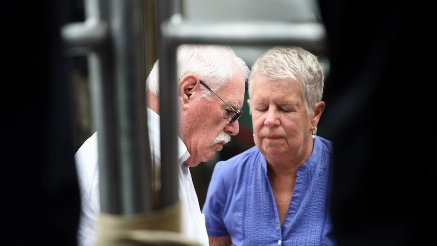 John and Mary Lyon, parents of  missing sisters Katherine and Shelia, listen during a news conference in Wheaton, Md., Wednesday, July 15, 2015, on developments in the investigation of the disappearance of 10-year-old Katherine Lyon and 12-year-old Shelia Lyon in 1975. Authorities on Wednesday announced first-degree murder charges against an imprisoned sex offender in the disappearance of two sisters from a suburban Maryland mall in 1975, bringing some clarity to the baffling case that made parents question whether to allow children out of their homes alone.  (AP Photo/Molly Riley)