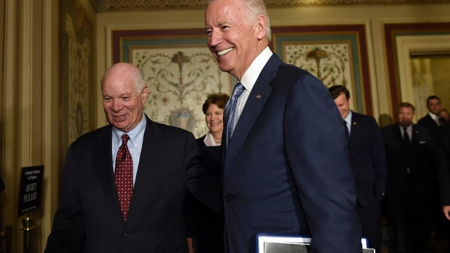 Vice President Joe Biden walks with Senate Foreign Relations Committee members Sen. Ben Cardin, D-Md., left, and Sen. Jeanne Shaheen, D-N.H., center, on Capitol Hill in Washington, Thursday, July 16, 2015, for a meeting with Democrats members of the committee to pitch the nuclear agreement with Iran. (AP Photo/Susan Walsh)