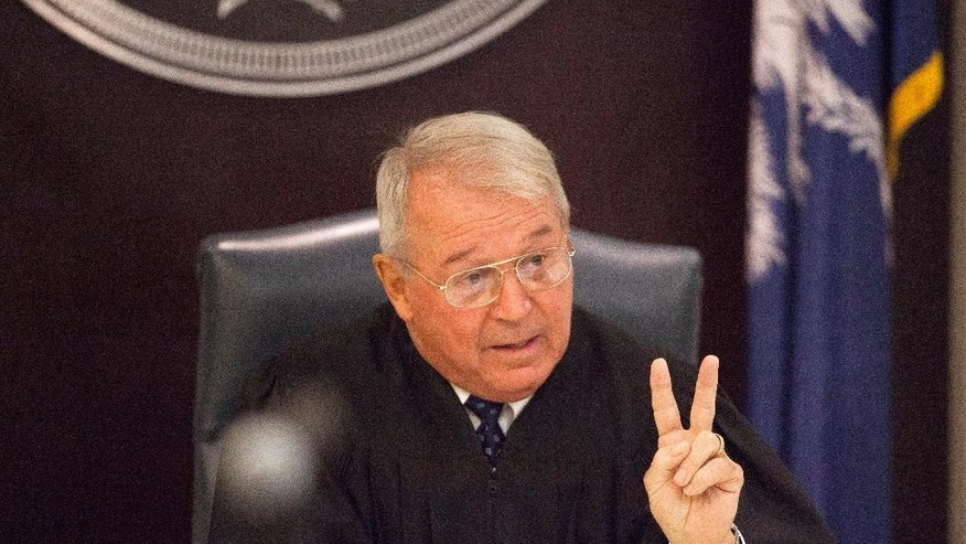 Circuit Judge J.C. Nicholson addresses the court during a hearing for Dylann Roof in Charleston, S.C., on Thursday, July 16, 2015. Nicholson ruled Thursday that Roof, accused of killing nine people at the Emanuel AME Church in Charleston in June, will stand trial in July, 2016. (Randall Hill, Pool Photo via AP)