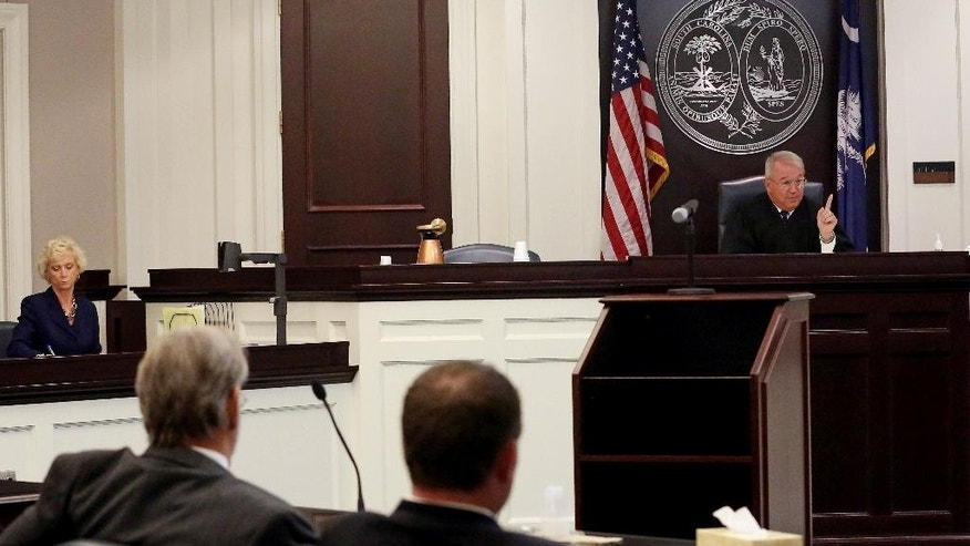 Circuit Judge J.C. Nicholson addresses the court during a hearing for Dylann Roof in Charleston, S.C., on Thursday, July 16, 2015. Nicholson ruled Thursday that Roof, accused of killing nine people at the Emanuel AME Church in Charleston in June, will stand trial in July, 2016. (Grace Beahm/The Post and Courier via AP, Pool)