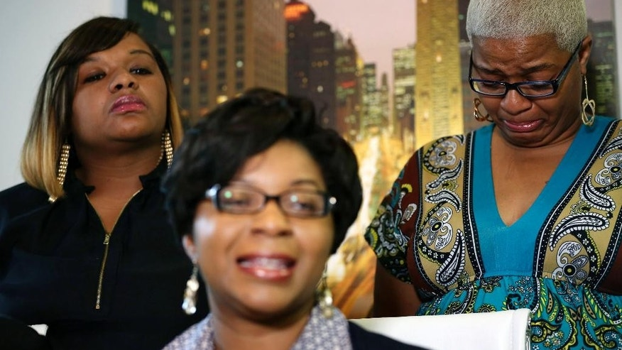 Sandra Bland's sisters Sharon Cooper, front, takes questions from the media, while her sisters Shavon Bland, left, and Shante Needham, become emotional, during a news conference about their sister's death Thursday, July 16, 2015 in Chicago. Sandra Bland, a 28-year-old woman who authorities say hanged herself in a Texas jail after her arrest for allegedly kicking an officer following a traffic stop gave no indication she was in such an emotional state that she would kill herself, her sister said Thursday. (Abel Uribe/Chicago Tribune via AP) MANDATORY CREDIT CHICAGO TRIBUNE; CHICAGO SUN-TIMES OUT; DAILY HERALD OUT; NORTHWEST HERALD OUT; THE HERALD-NEWS OUT; DAILY CHRONICLE OUT; THE TIMES OF NORTHWEST INDIANA OUT; TV OUT; MAGS OUT; NO SALES