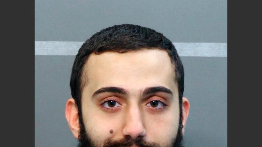 This April 2015 booking photo released by the Hamilton County Sheriffs Office shows a man identified as Mohammad Youssduf Adbulazeer after being detained for a driving offense. A U.S. official speaking on condition of anonymity identified the gunman in shootings at two Chattanooga military facilities as Muhammad Youssef Abdulazeez, who shares the same age and address as the man in the photo. (Hamilton County Sheriffs Office via AP)