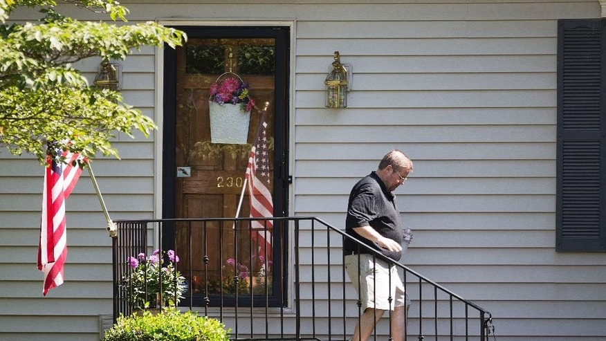Andy Kingery, spokesman for the family of Skip Wells, one of the four Marines killed in Thursday's shooting in Chattanooga, Tenn., walks out of the home of Well's mother, Cathy Wells, Friday, July 17, 2015, in Marietta, Ga. (AP Photo/David Goldman)