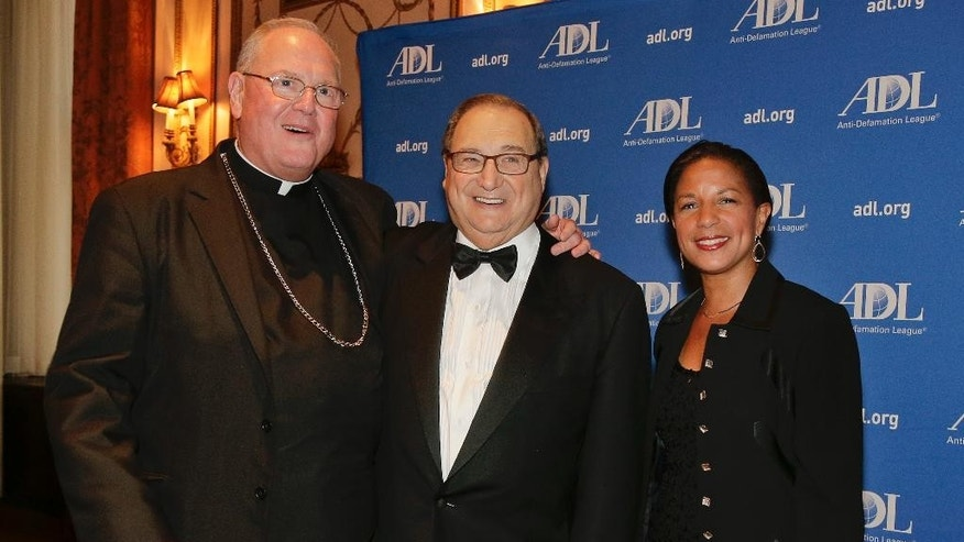 In this Wednesday, June 17, 2015 photo, Anti-Defamation League national director Abe Foxman, center, poses for photos with Cardinal Timothy Dolan, left, and national security advisor Susan Rice during a reception for a dinner in Foxman's honor in New York. After 28 years as head of the ADL, Foxman is retiring. No other U.S. Jewish leader has had his reach with policy makers, faith leaders and U.S. Jews. (AP Photo/Julie Jacobson)