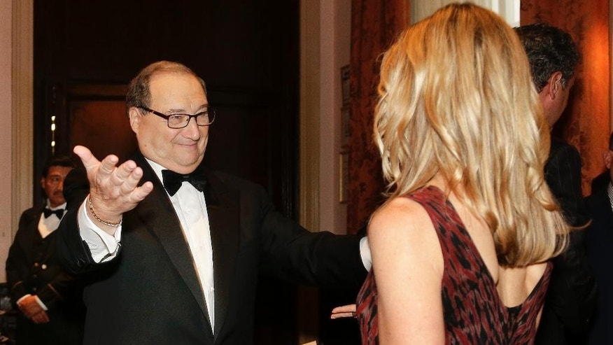 In this Wednesday, June 17, 2015 photo, Abe Foxman, left, Anti-Defamation League national director, greets Wendy Bazilian of San Diego during a reception for a dinner in his honor in New York. Foxman started with the ADL as a staff lawyer a half-century ago. (AP Photo/Julie Jacobson)