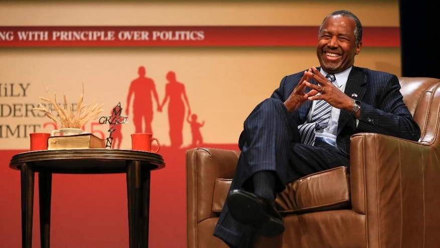 Republican presidential candidate, retired neurosurgeon Ben Carson, laughs while speaking at the Family Leadership Summit in Ames, Iowa, Saturday, July 18, 2015. (AP Photo/Nati Harnik)