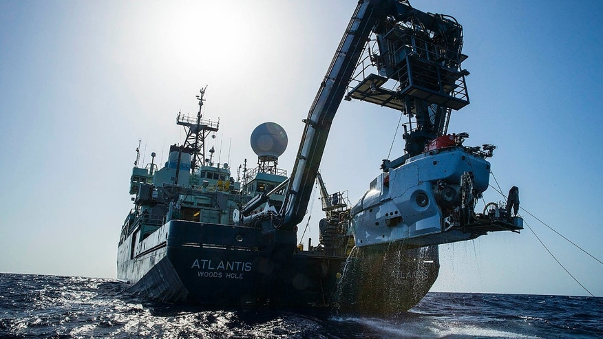 In this image released by, The Woods Hole Oceanographic Institution, the research vessel Atlantis is shown off the coast of the Carolinas in the Atlantic Ocean during the second week of July 2015 with the submersible Alvin hanging off its stern.