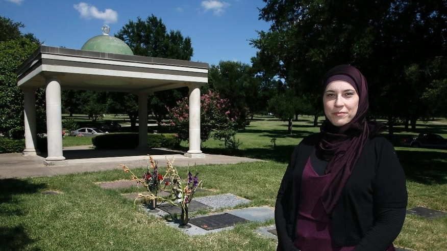 Alia Salem, executive director of the Dallas-Fort Worth chapter of the Council on American-Islamic Relations poses for a photo by an open-air pavilion in the Islamic Garden, a burial site for members of the Muslim faith that is part of the Restland Cemetery, Friday, July 17, 2015, in Dallas. A proposal to bring a Muslim cemetery to Farmersville has stoked fears among residents who are vehemently trying to convince community leaders to block the project. (AP Photo/Tony Gutierrez)