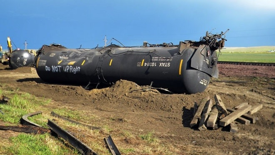 Federal railroad regulators say the oil train from North Dakota was traveling 44 miles per hour when it derailed and spilled 35,000 gallons.