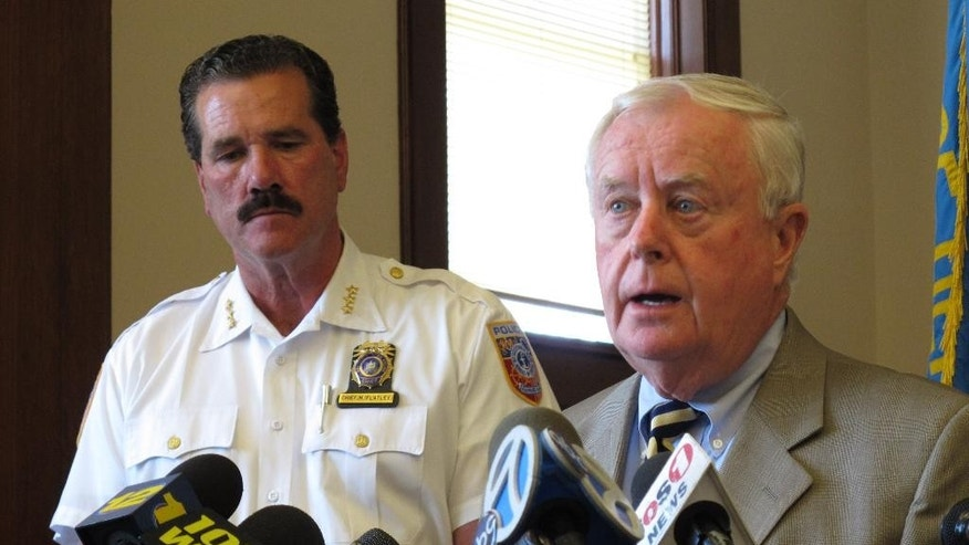 In this photo taken Monday, July 20, 2015, in Peconic, N.Y., Suffolk County District Attorney Thomas Spota, right, speaks at a news conference to discuss a fatal limousine accident two days earlier that left four women dead and four others seriously injured while leaving Long Island's wine country region. Looking on is Southold Town Police Chief Martin Flatley. (AP Photo/Frank Eltman)