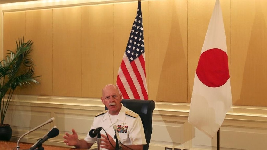 """Adm. Scott Swift, the new commander of the U.S. Pacific Fleet, speaks during a press conference in Tokyo Tuesday, July 21, 2015 during the last stop of a three-country Asian tour. The commander sounded a conciliatory note toward China. """"We have much more in common than we do in competition,"""" Swift told reporters. He added, though, that the Navy is ready to respond to any situation that might arise, if called upon by the American president. (AP Photo/Ken Moritsugu)"""