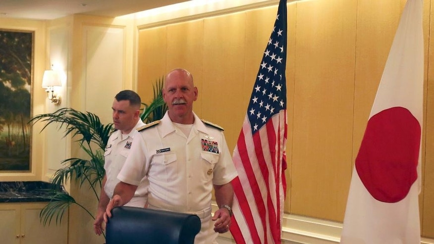 """Adm. Scott Swift, the new commander of the U.S. Pacific Fleet, arrives to hold a press conference in Tokyo Tuesday, July 21, 2015 during the last stop of a three-country Asian tour. The commander sounded a conciliatory note toward China. """"We have much more in common than we do in competition,"""" Swift told reporters. He added, though, that the Navy is ready to respond to any situation that might arise, if called upon by the American president. (AP Photo/Ken Moritsugu)"""