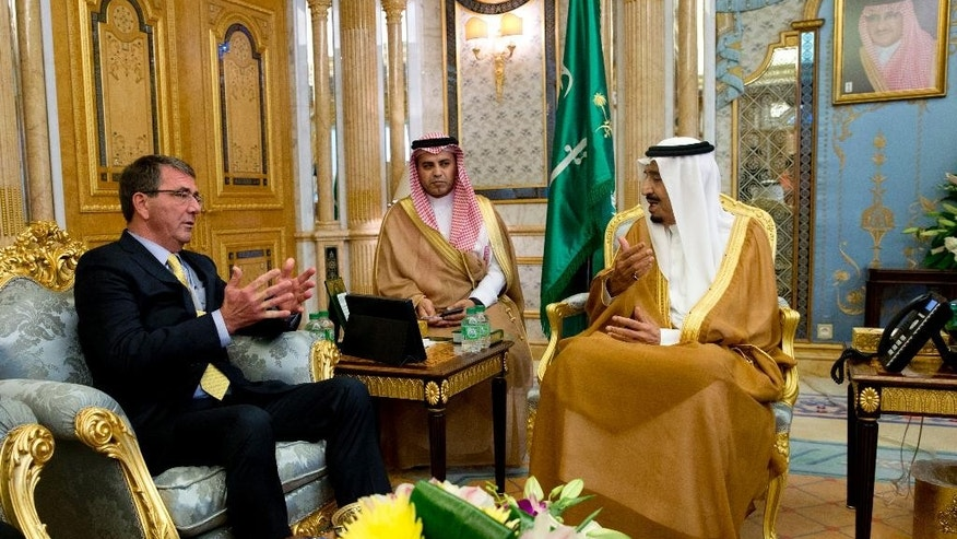 U.S. Defense Secretary Ash Carter, left, meets with Saudi Arabian King Salman bin Abdul Aziz, right, at Al-Salam Palace in Jiddah, Saudi Arabia, Wednesday, July 22, 2015. Carter flew to Saudi Arabia on Wednesday to consult with Saudi leaders, who are also unsettled by an Iran accord they see as likely to increase Iranian power and influence in the Persian Gulf and beyond. (AP Photo/Carolyn Kaster, Pool)