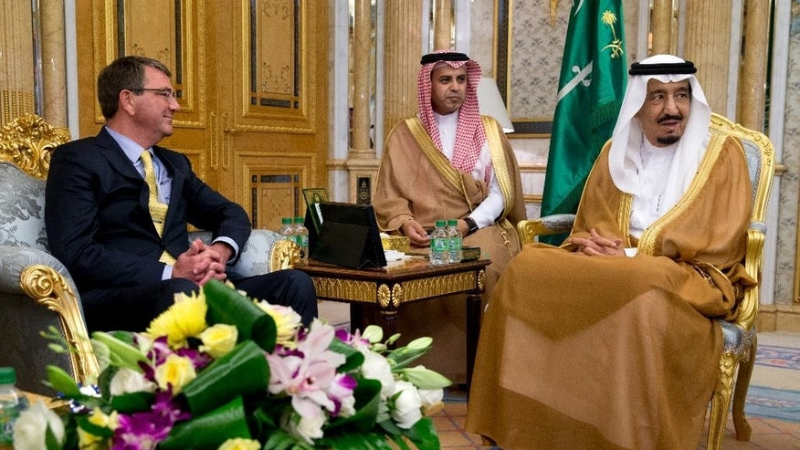 U.S. Defense Secretary Ash Carter meets with Saudi Arabian King Salman bin Abdul Aziz at Al-Salam Palace in Jiddah, Saudi Arabia, Wednesday, July 22, 2015. Carter flew to Saudi Arabia on Wednesday to consult with Saudi leaders, who are also unsettled by an Iran accord they see as likely to increase Iranian power and influence in the Persian Gulf and beyond. (AP Photo/Carolyn Kaster, Pool)