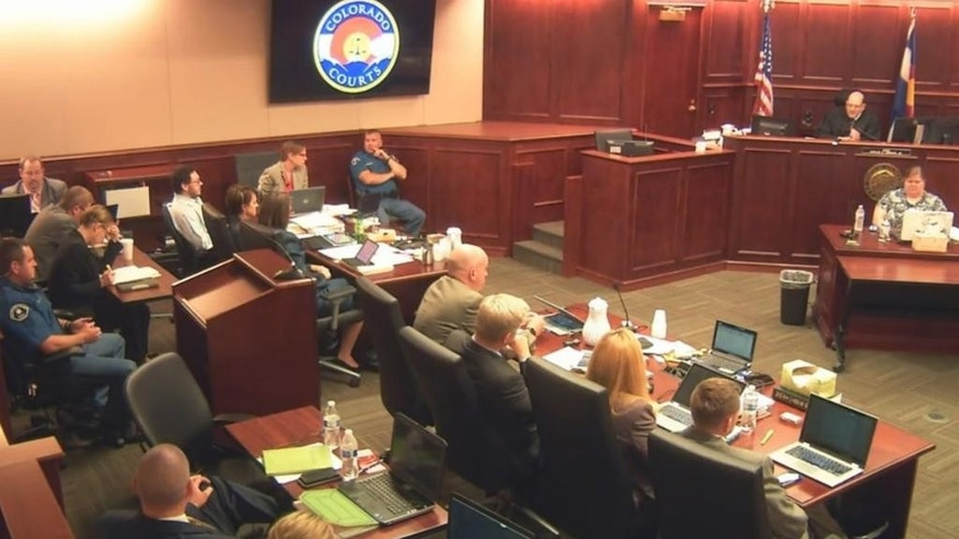 In this image taken from Colorado Judicial Department video, Colorado theater shooter James Holmes, fifth from left rear in light-colored shirt, sits in Arapahoe County District Court, where his trial continued Wednesday, July 22, 2015, in Centennial, Colo. The penalty phase of the trial of Holmes, who could be sentenced to death for killing 12 people in a Colorado movie theater, began Wednesday morning with the judge giving instructions to the jury. (Colorado Judicial Department via AP, Pool)
