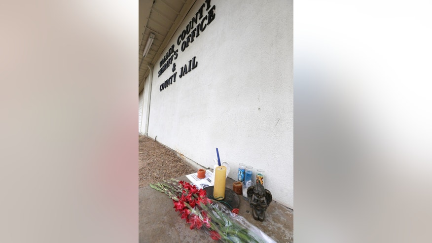 A memorial sits outside the Waller County Jail, Wednesday, July 22, 2015, in Hempstead, Texas, where Sandra Bland died in a cell.  Bland was arrested and taken to a jail about 60 miles (100 kilometers) northwest of Houston on July 10 and found dead July 13. Officials say Bland hanged herself with a plastic garbage bag in her jail cell, a contention her family and supporters dispute. (AP Photo/Pat Sullivan)