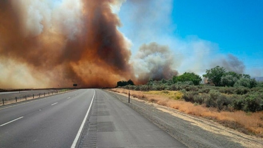 July 20, 2015: A brush fire burns in central Washington near the town of George. Several wildfires lit up Washington state on Tuesday, closing freeways, destroying at least one home and threatening dozens of others.