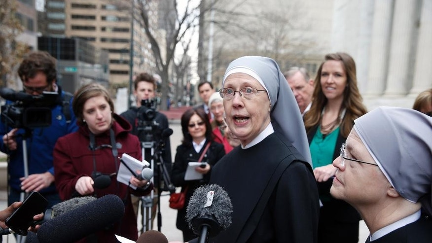 File - In this Dec. 8, 2014, file photo, Sister Loraine Marie Maguire, of Little Sisters of the Poor, speaks to members of the media after attending a hearing in the 10th U.S. Circuit Court of Appeals, in Denver, Colo. Attorneys for Little Sisters of the Poor and four Oklahoma Christian colleges announced Thursday, July 23, 2015 that they will appeal the previous week's ruling from the 10th Circuit Court of Appeals in Denver that found that President Obama's health care law adequately protects them from having to provide coverage of contraception for their employees. (AP Photo/Brennan Linsley, file)