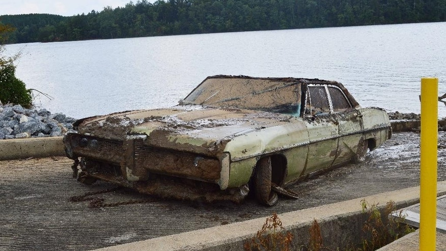 This photo provided by the Caldwell County Sheriff's Office shows a 1968 Pontiac Catalina that was pulled from Lake Rhodhiss in North Carolina on Tuesday July 21, 2015. It contained remains that are believed to be those of Amos Shook. Shook was reported missing in 1972, and his case remained unsolved until investigators searched the lake with sonar at the family's request. (AP Photo/Caldwell County (N.C.) Sheriff's Office)