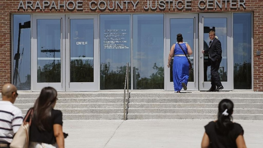 People enter the Arapahoe County District Court, where the trial of convicted Aurora movie theater shooter James Holmes continued Wednesday, July 22, 2015, in Centennial, Colo. The penalty phase of the trial of Holmes, who could be sentenced to death for killing 12 people in a Colorado movie theater, began Wednesday morning with the judge giving instructions to the jury. (AP Photo/Brennan Linsley)