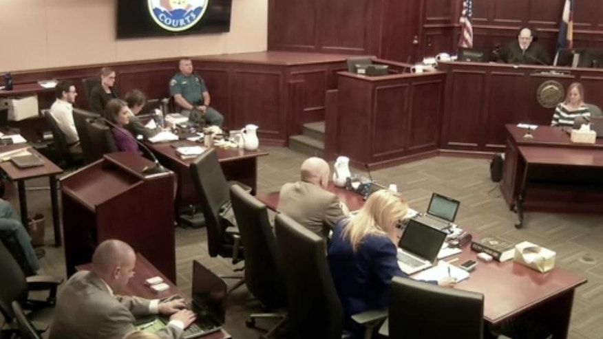 In this image taken from Colorado Judicial Department video, Colorado theater shooter James Holmes, top left in light-colored shirt, sits in Arapahoe County District Court, where his trial continues Thursday, July 23, 2015, in Centennial, Colo. The penalty phase of the trial of Holmes, who could be sentenced to death for killing 12 people in a Colorado movie theater, began Wednesday (Colorado Judicial Department via AP, Pool)