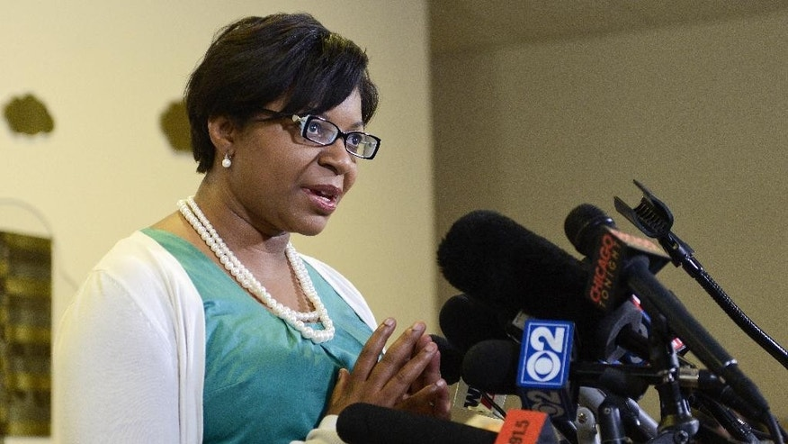 Sharon Cooper, sister of Sharon Bland, addresses the media during a news conference at Dupage African Methodist Episcopal Church on Wednesday, July 22, 2015, in Lisle, Ill.   Bland was arrested and taken to the Waller County jail, about 60 miles (100 kilometers) northwest of Houston on July 10 and found dead July 13. Officials say Bland hanged herself with a plastic garbage bag in her jail cell, a contention her family and supporters dispute.  (AP Photo/Matt Marton)