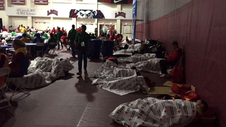 July 22, 2015: This photo provided by KNX1070 Newsradio shows Special Olympics competitors sleeping on the gymnasium floor at Loyola Marymount University in Los Angeles.