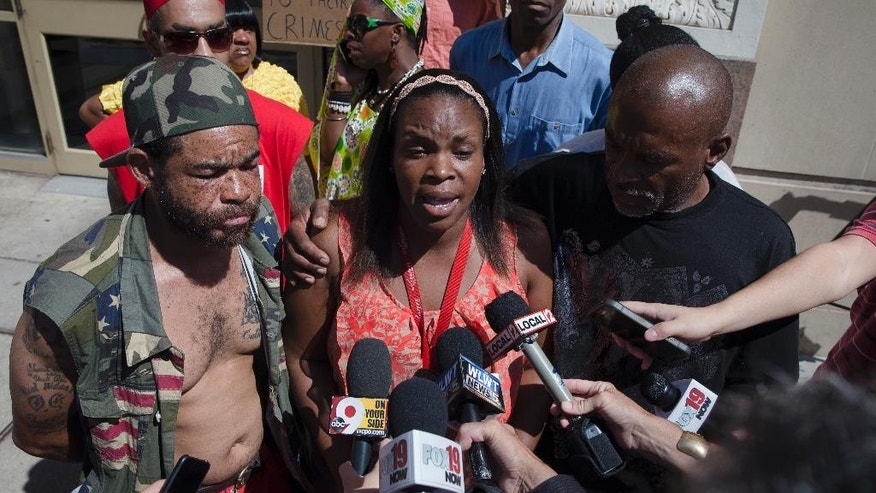 Ebony Johnson, cousin of Samuel Dubose, speaks to the media outside the office of Hamilton County prosecutor Joe Deters' office during a protest demanding release of video showing the shooting death of Dubose by a University of Cincinnati police officer, Thursday, July 23, 2015, in Cincinnati. Deters has said he won't release the video until the investigation into Sunday's shooting is complete. (AP Photo/John Minchillo)