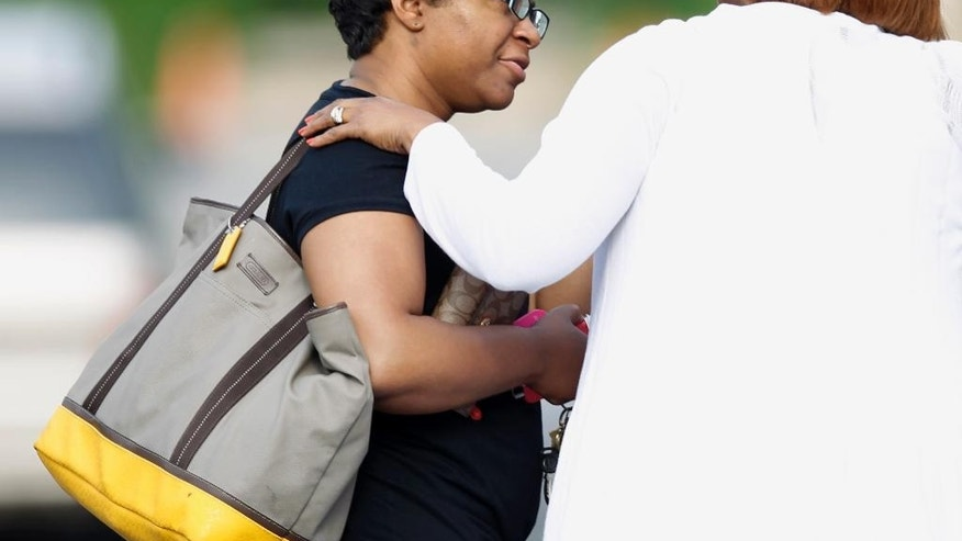 CORRECTS FIRST NAME TO SHARON, NOT SANDRA COOPER - Sandra Bland's sister Sharon Cooper arrives at the wake service for Sandra Bland at the DuPage African Methodist Episcopal Church Saturday, July 25, 2015, in Lisle, Ill. An autopsy report released Friday found that Sandra Bland used a plastic trash bag to hang herself three days after a confrontational traffic stop. The 28-year-old woman's family has questioned the findings, saying she was excited about starting a new job and wouldn't have taken her own life.  (AP Photo/Christian K. Lee)