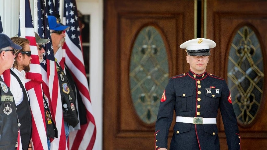 A U.S. Marine walks out of the visitation of Lance Cpl. Skip Wells, Friday, July 24, 2015, in Kennesaw, Ga. The Georgia Marine gunned down at a Navy-Marine reserve center in Chattanooga, Tenn., will be buried following his funeral Sunday at Georgia National Cemetery in Canton. (AP Photo/David Goldman)