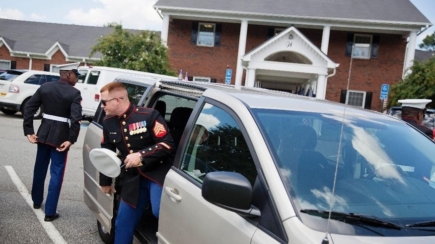 U.S. Marines arrive for the visitation of Lance Cpl. Skip Wells, Friday, July 24, 2015, in Kennesaw, Ga. The Georgia Marine gunned down at a Navy-Marine reserve center in Chattanooga, Tenn., will be buried following his funeral Sunday at Georgia National Cemetery in Canton. (AP Photo/David Goldman)
