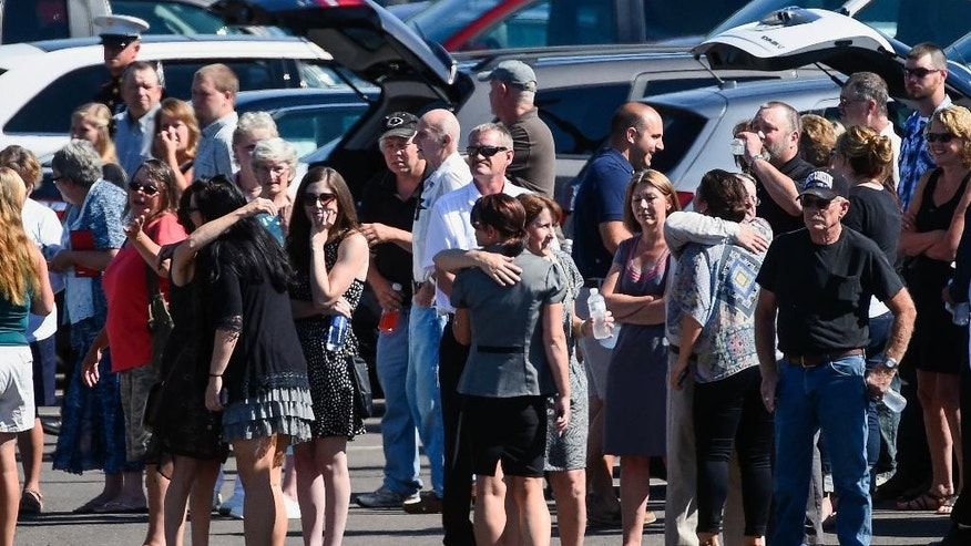 Mourners gather for a public visitation for Sgt. Carson Holmquist at Grantsburg High School in Grantsburg, Wis., Saturday, July 25, 2015. Holmquist was killed by a gunman in Chattanooga, Tenn. (AP Photo/Craig Lassig)