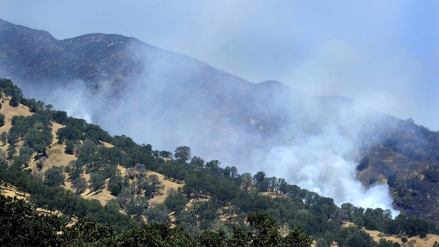 July 24, 2015: Smoke billows along a ridgeline at the southern most portion of the Wragg Fire near Winters, Calif.