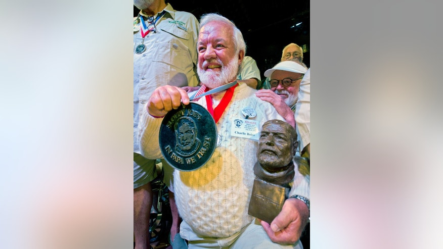 "In this Saturday, July 25, 2015 photo provided by the Florida Keys News Bureau, Charlie Boice beams after winning the 2015 ""Papa"" Hemingway Look-Alike Contest at Sloppy Joe's Bar in Key West, Fla. Boice finally won the contest after 15 attempts, beating out 121 other entrants following two preliminary rounds, semi-finals and two final rounds. The competition was a facet of the subtropical island's annual Hemingway Days festival that ends Sunday, July 26. Ernest Hemingway lived and wrote in Key West throughout the 1930s. (Andy Newman/Florida Keys News Bureau via AP)"