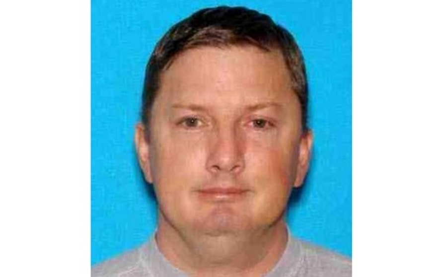 Neal Falls, 45, is pictured here in a photo provided by the Charleston Police Department.