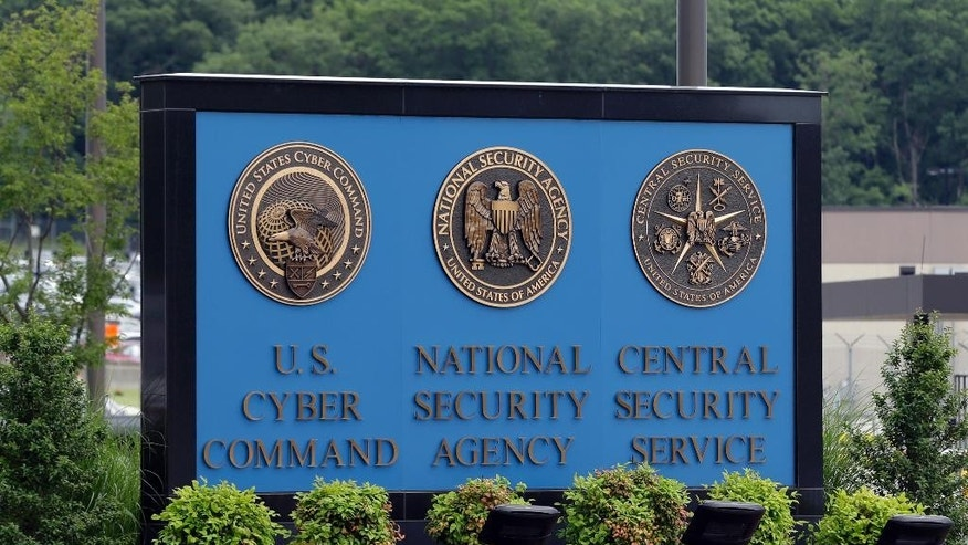 FILE - In this June 6, 2013, file photo, a sign stands outside the National Security Administration (NSA) campus on in Fort Meade, Md. The Obama administration has decided that the National Security Agency will soon stop using millions of American calling records it collected under a controversial program leaked by former agency contractor Edward Snowden. The Director of National Intelligence said July 27,  that as of Nov. 29, those records would no longer be examined in terrorism investigations, and would be destroyed as soon as possible. (AP Photo/Patrick Semansky, File)