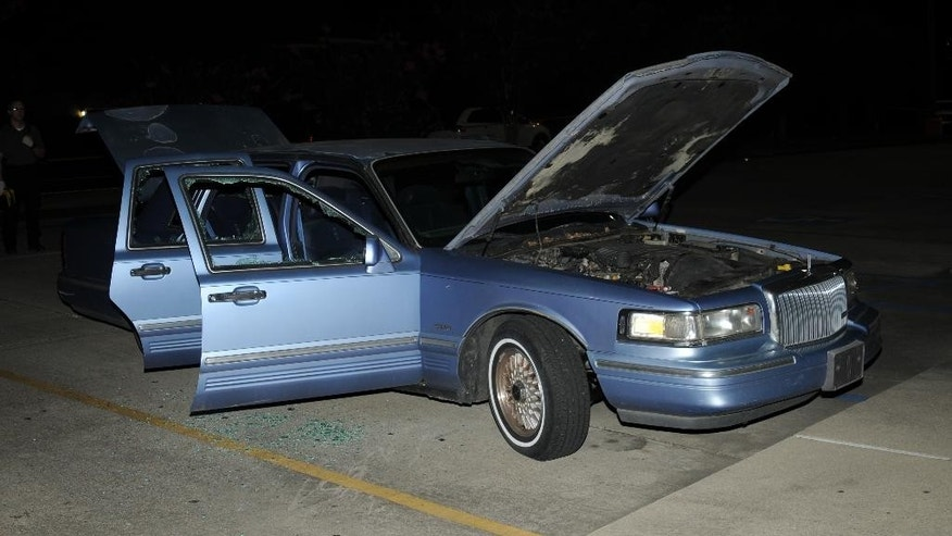 This undated photo provided by the Lafayette Police Department shows the car John Russel Houser was driving before he opened fire in a movie theater July 23, 2015, in Lafayette, La. Lafayette police said in an email Tuesday, July 28, that they are releasing the photographs in hopes that people may have seen the blue 1995 Lincoln Continental and may remember encountering Houser. (Lafayette Police Department via AP)
