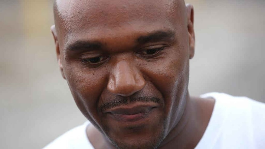 "In this Aug. 31, 2012 photo, Alprentiss Nash, who was been behind bars since his murder conviction in 1995, walks free from the Menard Correctional Center in downstate Chester, Ill., after Cook County prosecutors dropped the case against him. Chicago Police said Wednesday, July 29, 2015, that Nash was fatally shot in Chicago, Tuesday, July 28 after after an argument during ""some sort of transaction"" between Nash and his attacker. (E. Jason Wambsgans/Chicago Tribune via AP)"