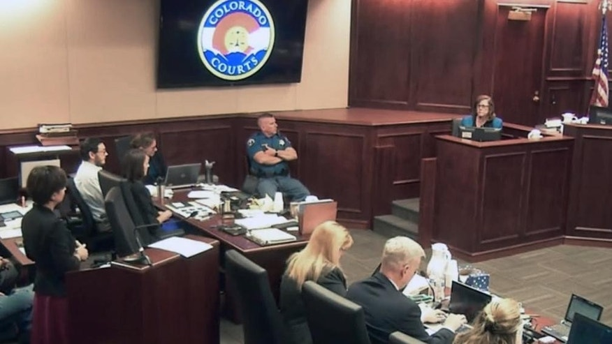 In this image made from Colorado Judicial Department video, Arlene Holmes, top right, the mother of James Holmes, second from left, in white shirt, gives testimony during the sentencing phase of the Colorado theater shooting trial in Centennial, Colo., on Wednesday, July 29, 2015. Once they begin deliberating on the sentence, the Holmes jury will be charged with deciding if Holmes is to be executed, or if any mitigating evidence, such as mental health issues, warrants instead life in prison. (Colorado Judicial Department via AP, Pool)