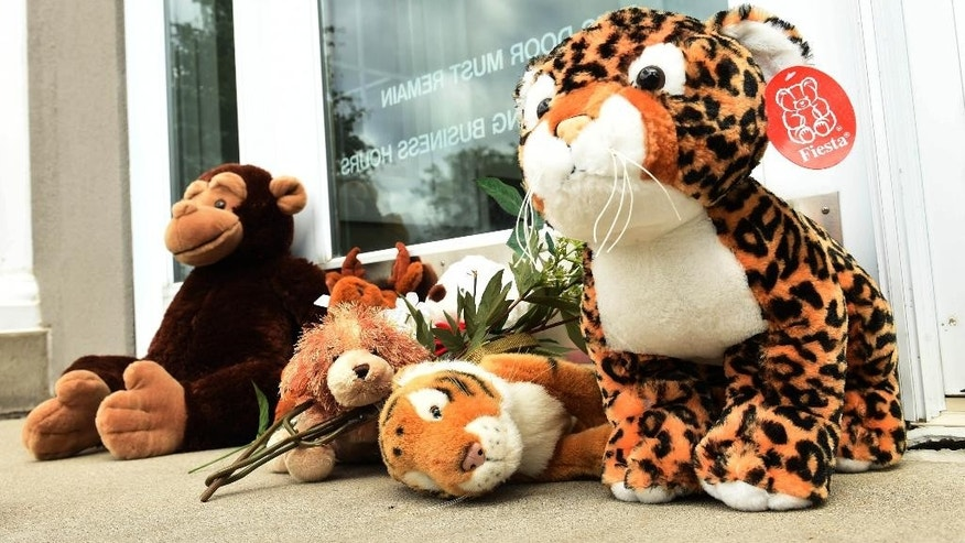 Stuffed animals adorn the doorstep of Dr. Walter Palmer's River Bluff Dental office in Bloomington, Minn.