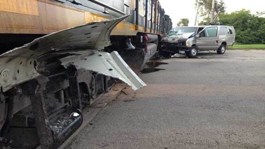 July 28, 2015: This photo shows the aftermath of a collision between a van and a train in Middletown, Ohio. One woman was killed and ten others, including nine children, were hospitalized, authorities said. (Dave Smith/Fox19)