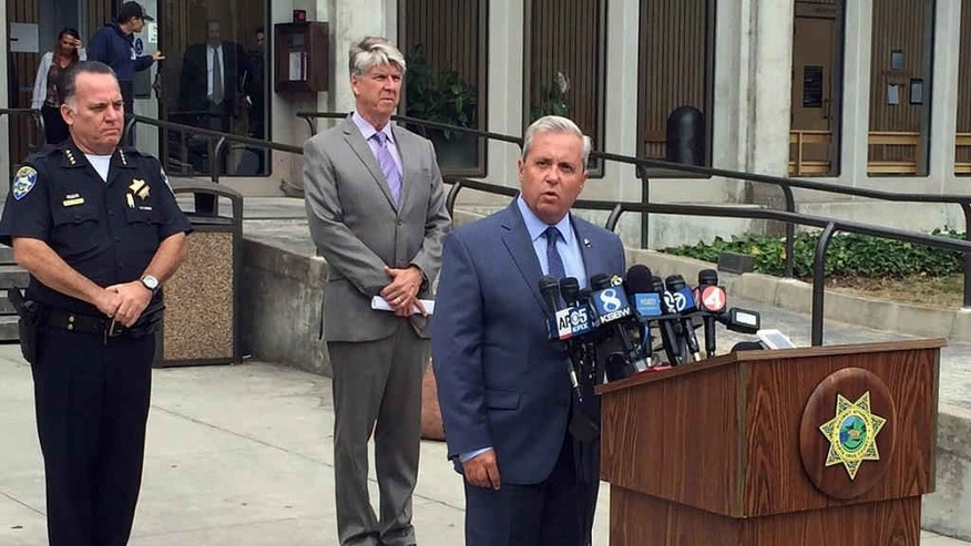 Santa Cruz District Attorney Jeffrey Rosell, right, holds a news where he announced that 15-year-old Adrian Jerry Gonzalez will be charged as an adult in the murder of 8-year-old Madyson Middleton in Santa Cruz, Calif., Wednesday, July 29, 2015.  Police say Gonzalez lured  Middleton from a courtyard where she had been riding her scooter over the weekend into his family's apartment where he attacked and killed her. (AP Photo/Terry Chea)