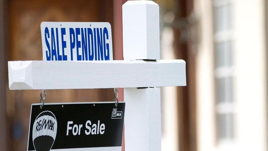"FILE - In this Thursday, Jan. 8, 2015, file photo, a ""sale pending"" sits atop a realty sign outside a home for sale in Surfside, Fla. The National Association of Realtors releases its pending home sales index for June on Wednesday, July 29, 2015. (AP Photo/Wilfredo Lee, File)"