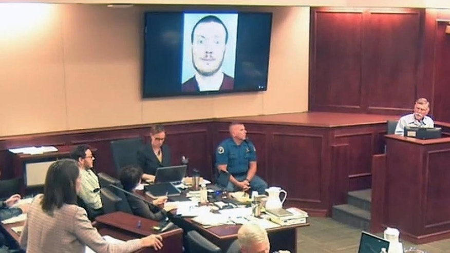 FILE - In this July 28, 2015, file image, made from Colorado Judicial Department video, defense attorney Tamara Brady, left, questions Robert Holmes, top right, the father of James Holmes, background left in white shirt, during the sentencing phase of the Colorado theater shooting trial in Centennial, Colo. A fuller portrait of the Colorado movie theater shooter has emerged during Holmes' death penalty trial. Testimony given by Holmes' parents revealed a family laid bare by the tragic consequences of a son's incomprehensible descent from a well–behaved child with a quirky sense of humor into a killer capable of gunning down defenseless strangers. (Colorado Judicial Department via AP, Pool, File)