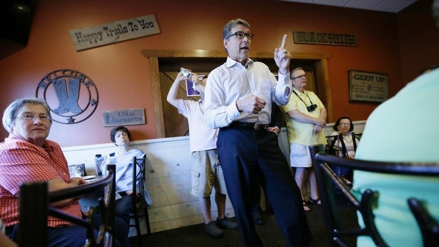 In this July 13, 2015, photo, Republican presidential candidate former Texas Gov. Rick Perry speaks during a meet and greet with local residents in Fort Dodge, Iowa. Perry's devout Christian beliefs were a centerpiece of his short-lived 2012 White House bid but are an afterthought in his second-chance campaign across Iowa. (AP Photo/Charlie Neibergall)