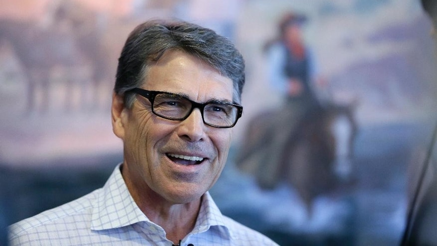 In this July 13, 2015, photo, Republican presidential candidate former Texas Gov. Rick Perry speaks to the media following a meet and greet with local residents in Fort Dodge, Iowa. Perry's devout Christian beliefs were a centerpiece of his short-lived 2012 White House bid but are an afterthought in his second-chance campaign across Iowa.  (AP Photo/Charlie Neibergall)