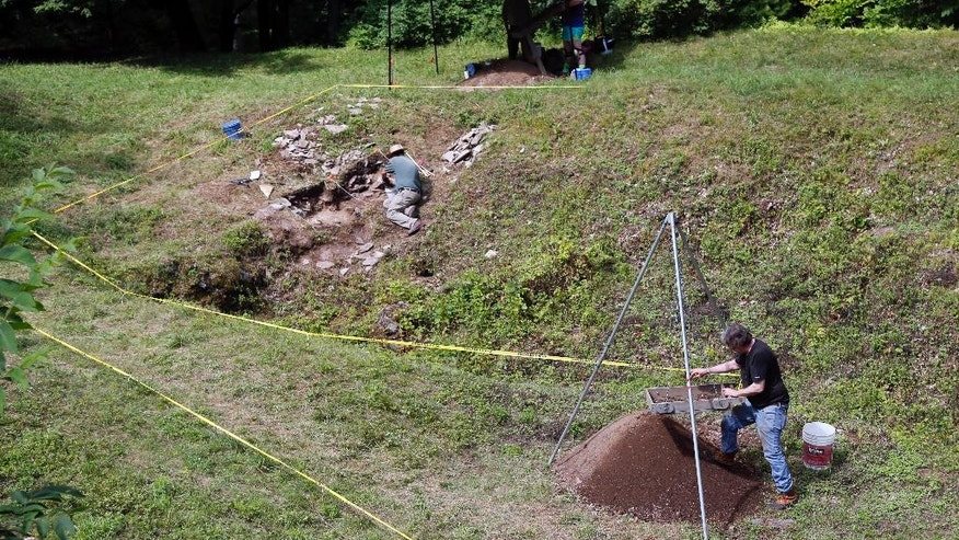 In this Thursday, July 23, 2015 photo, workers look for artifacts at an archaeological dig at Lake George Battlefield Park in Lake George, N.Y. (AP Photo/Mike Groll)