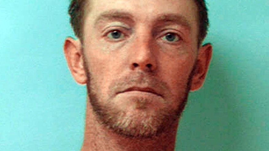 This undated photo provided by the Armstrong County Jail shows Robert Crissman. Armstrong County officials say Crissman ran from jail Thursday morning, July 30, 2015, while delivering meals to other inmates. Authorities say Crissman is suspected of killing a woman in her Kittanning, Pa., home and then taking her 1999 Chevrolet Silverado pickup truck after escaping. (Armstrong County Jail via AP)