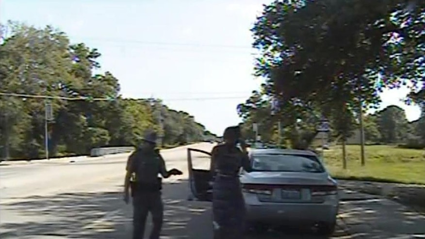 "FILE- In this July 10, 2015 file frame from dashcam video provided by the Texas Department of Public Safety, trooper Brian Encinia arrests Sandra Bland after she became combative during a routine traffic stop in Waller County, Texas. Encinia, a Texas trooper who arrested Bland after a confrontation that began with a traffic stop, had been cautioned about ""unprofessional conduct"" in a 2014 incident while he was still a probationary trooper. (Texas Department of Public Safety via AP, File)"
