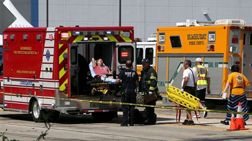 A man is loaded into an ambulance following a fatal tent collapse at the Prairie Fest in Wood Dale, Ill., Sunday, Aug. 2, 2015. (Stacey Wescott/Chicago Tribune via AP)